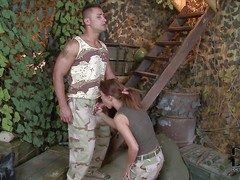 Redhead hottie Denise enjoys there brawny head around her soldier