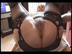 Hairy big-titted mature girl in slide and girdle does upskirt and